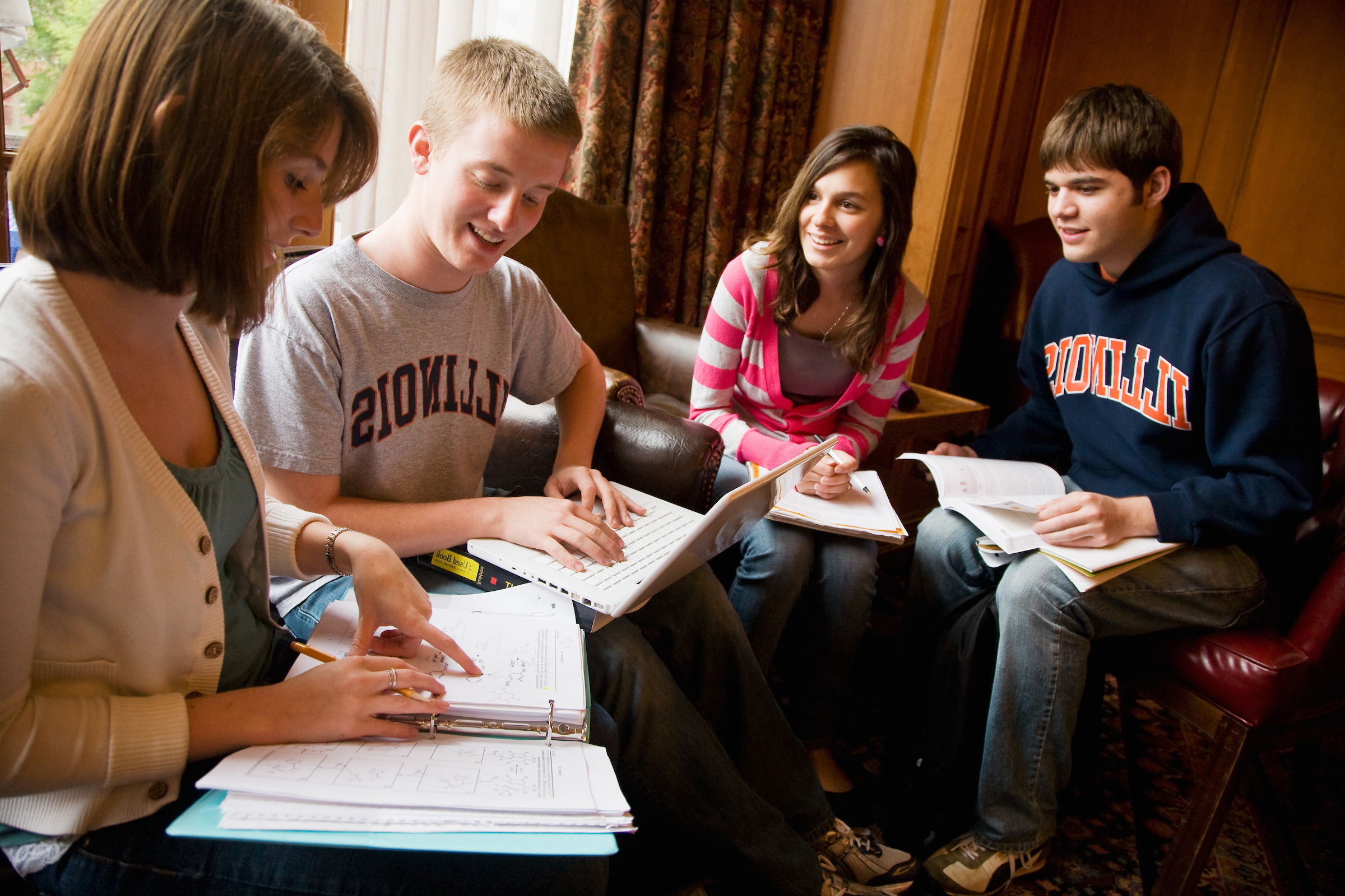 Group of students studying in the South Lounge of the Illini Union.